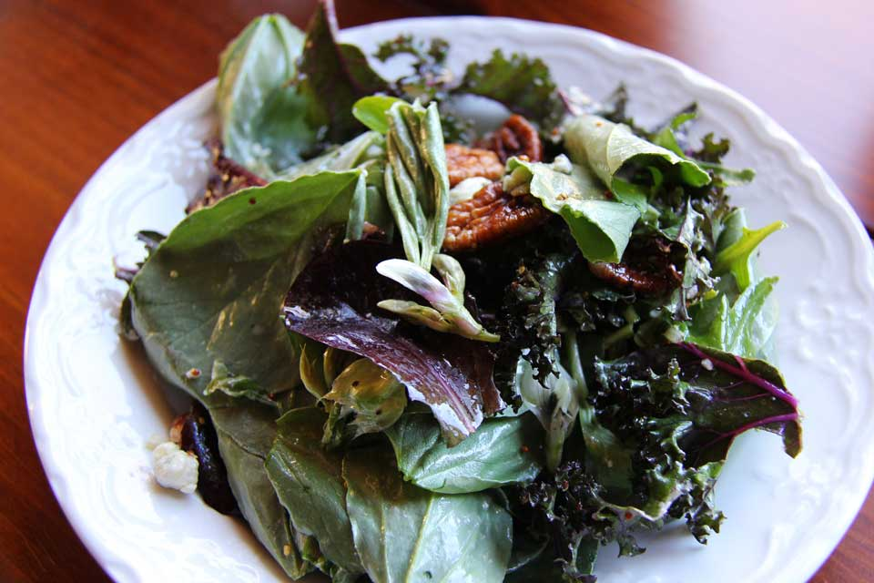 Fava leaf and red Russian kale salad with Point Reyes Farmstead bleu cheese and pecan
