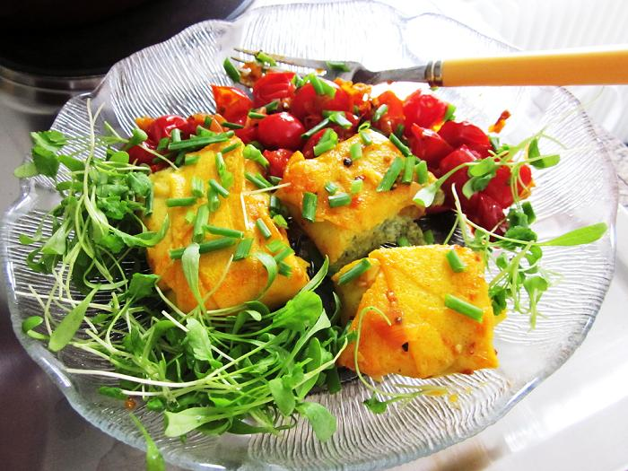 Crepes stuffed with ricotta and spinach, served with vodka and chili spiked cherry tomatoes and microgreens.